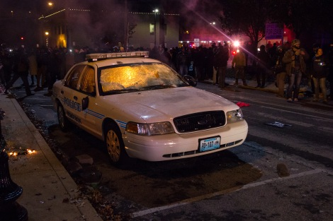 A Ferguson police car burns in front of City Hall on November 26, 2014.