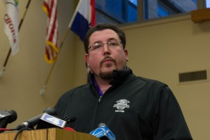 Ferguson Mayor Knowles announcing Chief Jackson's resignation at a press conference in Ferguson City Hall.