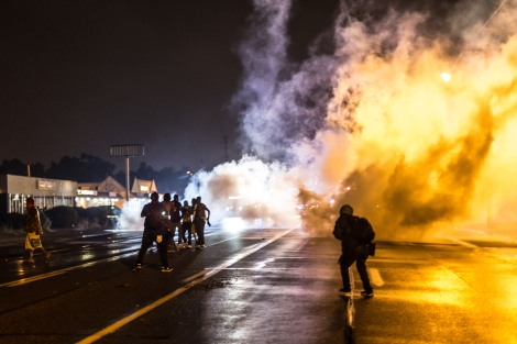 Protesters running from tear gas in Ferguson, MO on August 17, 2014.