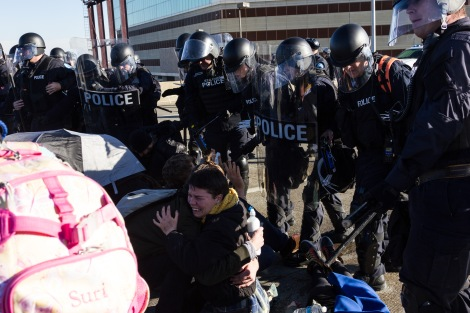 Police preparing to make arrests after macing protesters for shutting down an interstate in St. Louis, MO on November 26, 2014.