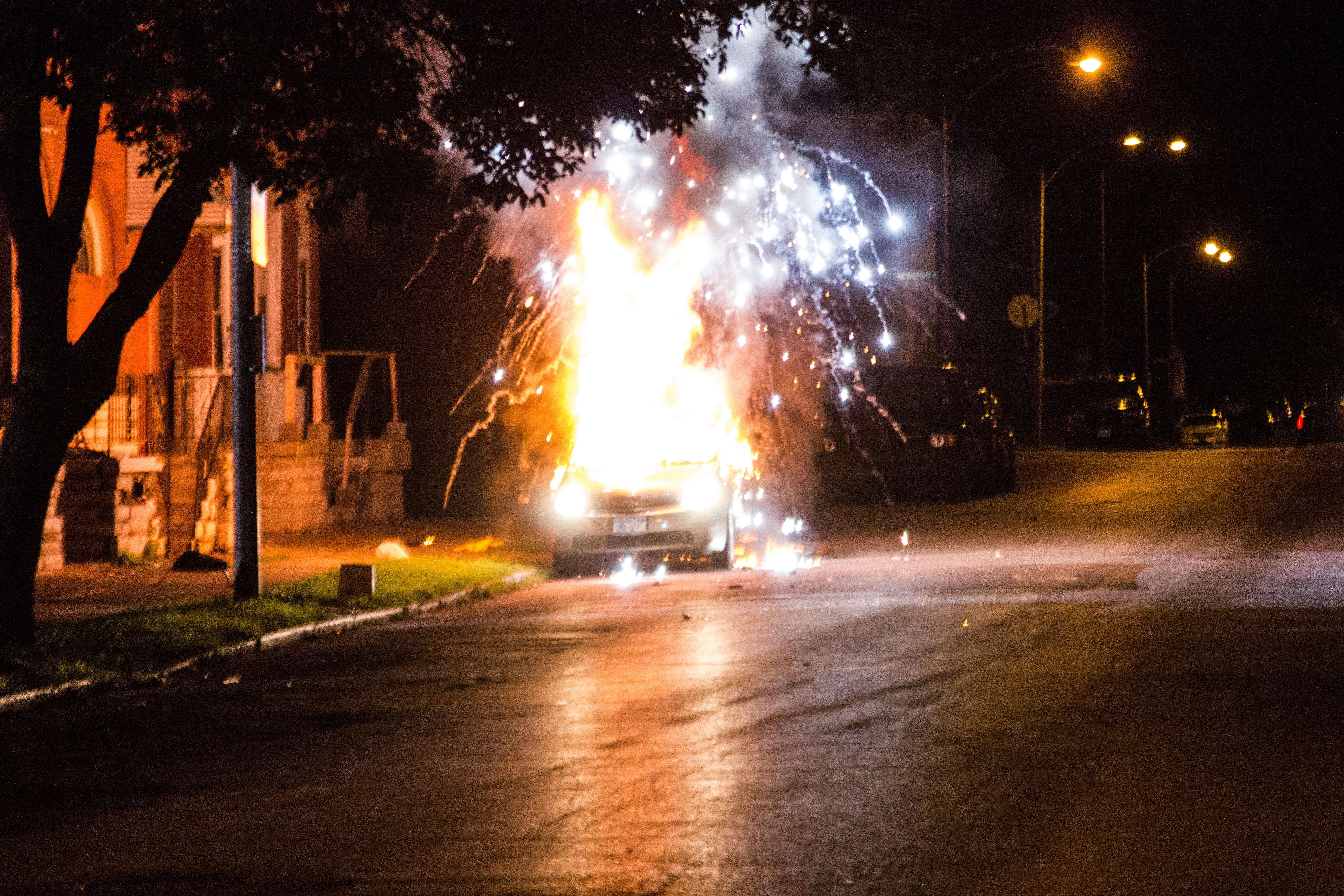 A Prius explodes after being set on fire during a protest in the Fountain Park neighborhood