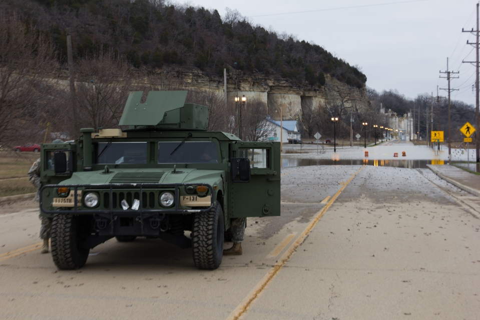 The Nation Guard keeping traffic from driving into floods in Pacific, MO.