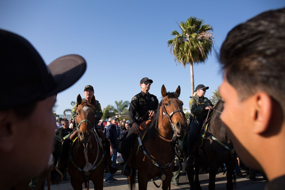 Mounted police separate Trump supporters and protesters at the Donald Trump rally in Costa Mesa, CA.