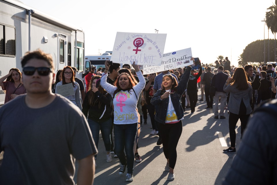 Protesters march down the long line of Donald Trump supporters in Costa Mesa, CA.