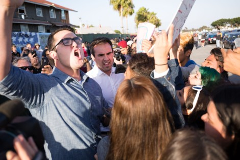 Donald Trump supporters argue with protesters while in line to get into the rally in Costa Mesa, CA.