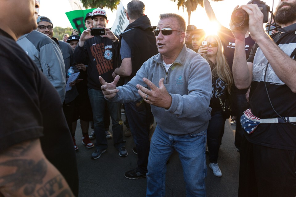 A man has a heated argument with Trump protesters outside the rally in Costa Mesa, CA.