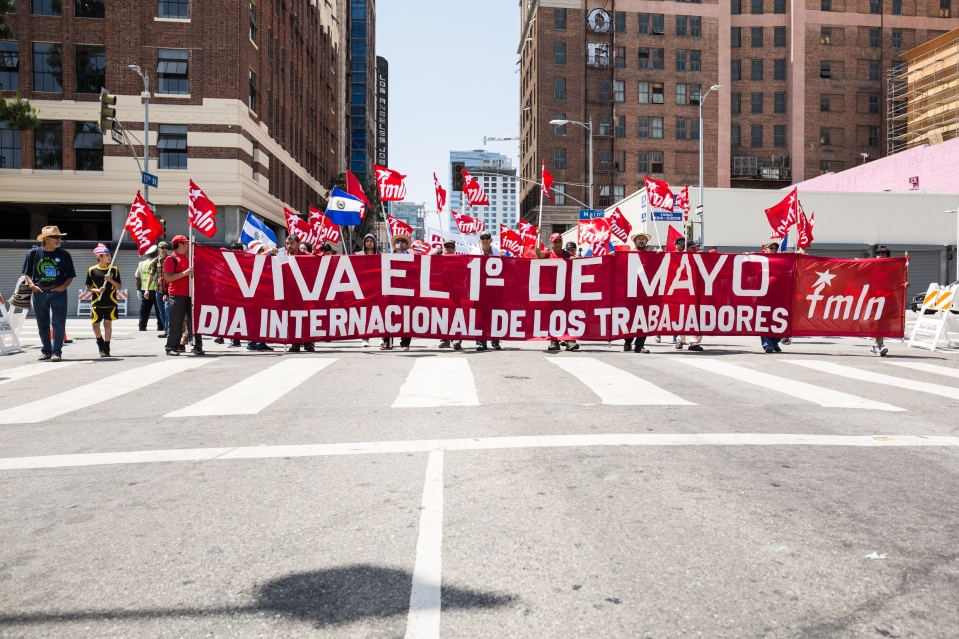 Members of the Farabundo Martí National Liberation Front of Los Angeles march behind a banner in the International Workers'day march.