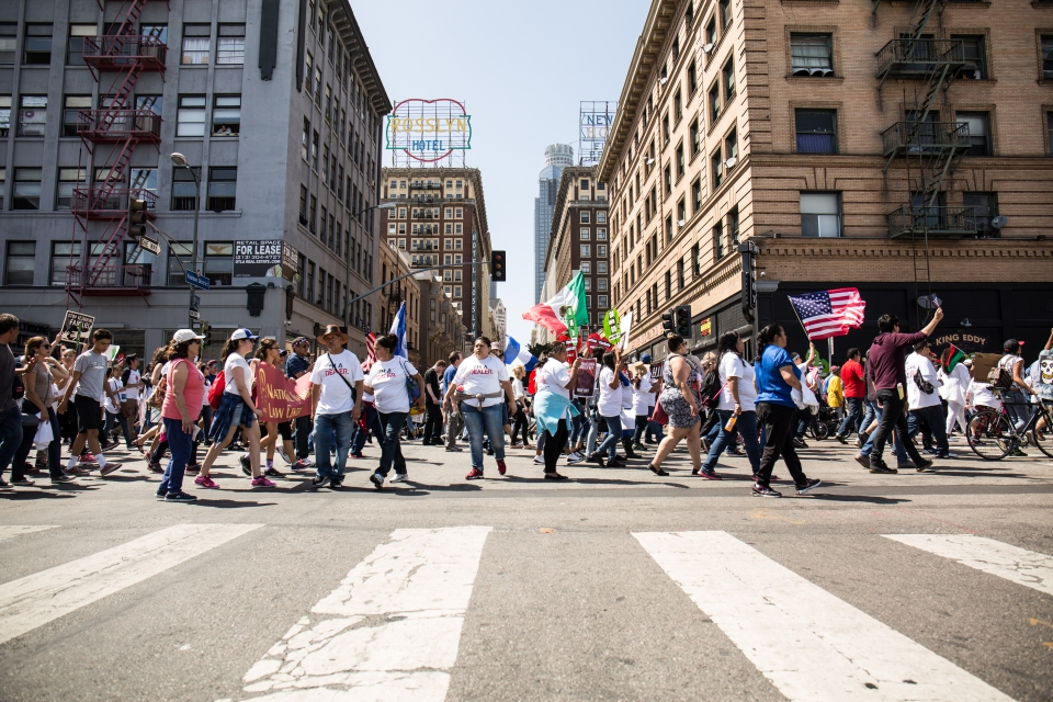 Protesters waving American and Mexican flags in the International Workers' Day march.