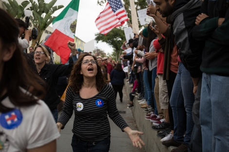 Some Clinton supporters attempt to engage the anti-Clinton protesters as they leave the event held at East Los Angeles College on May 5, 2016.